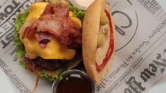 Bacon On Cheeseburger Sandwich - stock footage