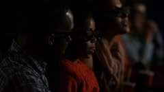 4K Young family watching a film with 3D glasses in crowded movie theatre Stock Footage