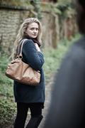 Young Woman Feeling Threatened As She Walks Home - stock photo