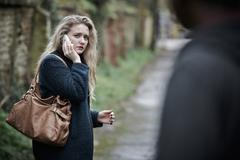 Teenage Girl Feeling Threatened As She Walks Along Path - stock photo