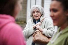 Senior Woman Feeling Intimidated By Teenage Girls - stock photo