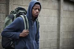 Homeless Teenage Boy On Streets With Rucksack - stock photo