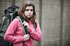Homeless Teenage Girl On Street With Rucksack Stock Photos