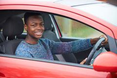 Newly Qualified Teenage Boy Driver Sitting In Car Stock Photos
