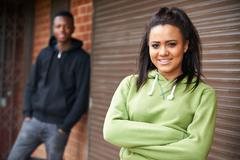 Stock Photo of Portrait Of Teenage Couple In Urban Setting