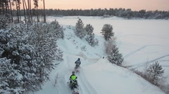 Stock Video Footage of Snowmobile races on the frozen lake
