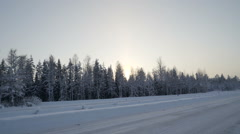 Travelling along the snowy road in Scandinavia - stock footage