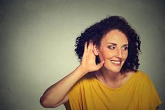 Happy middle aged nosy woman hand to ear gesture carefully secretly listening Kuvituskuvat