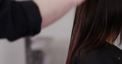 Hair dresser working on a woman's hair. Shot on RED Epic. Stock Footage