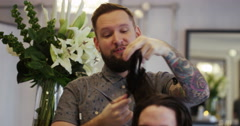Hair dresser working on a man's hair. Shot on RED Epic. Stock Footage