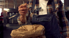 Brewery worker pouring hop grains Stock Footage