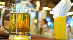 Closeup of Cold Pint of Beer on Bar Counter Stock Footage