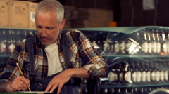 Brewery workers checking info on a tablet Stock Footage