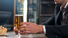 Anxious businessman drinking beer - stock footage
