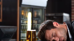 Businessman with beer falling asleep Stock Footage