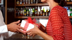 Man offering surprising his wife with gift Stock Footage
