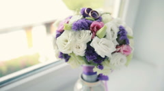 Wedding Rings on Wedding Bouquet Stock Footage