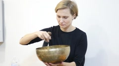 Sound meditation - woman play the copper bowls - stock footage