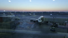 Passengers boarding flight, plane before takeoff, timelapse of airport at dusk Stock Footage