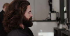 Stock Video Footage of Hipster after having his hair groomed looks into the camera. Shot on RED Epic.