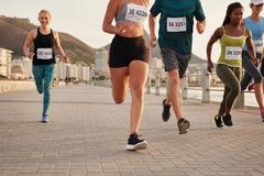 Female runners competing in a race Stock Photos