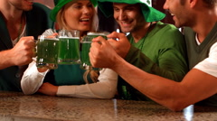 Happy friends celebrating St Patrick day Stock Footage