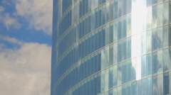 Vertical pan shot of modern glass building, windows of office center, sunny day Stock Footage