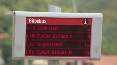 Municipal public transport schedule information on LED board at the bus stop Stock Footage