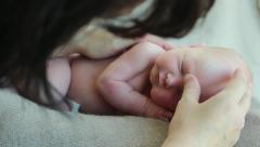 Newborn photo shoot 10 lulling baby Stock Footage
