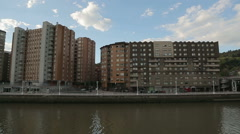 Industrial district architecture, gloomy apartment buildings along river bank Stock Footage