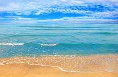 Stock Photo of sea beach blue sky sand sun daylight