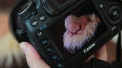 Newborn photo shoot 27 shot Stock Footage