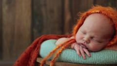 Newborn photo shoot 32 baby on the background boards Stock Footage