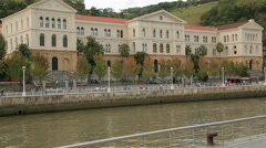 University of Deusto on Nervion river bank in Bilbao, classical architecture Stock Footage