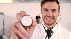 Portrait of a doctor holding stethoscope Stock Footage