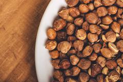 Stock Photo of Plenty of ripe hazelnuts on plate
