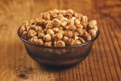 Stock Photo of Plenty of ripe hazelnuts in bowl