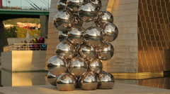Tall Tree and the Eye outside Guggenheim Museum, sculpture of steel spheres Stock Footage