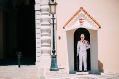 Honor guard on duty at royal palace, residence of Prince of Mona Stock Photos