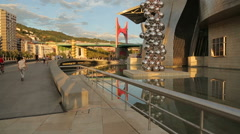 Places of tourist interest in Bilbao, many people walking by Guggenheim Museum - stock footage