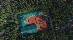 Aerial view of tennis court in forest Stock Footage