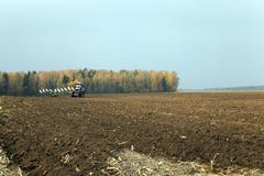 agricultural plowed field - stock photo