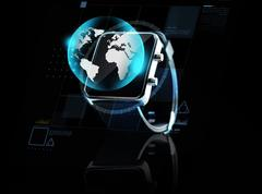 close up of smart watch with earth globe - stock photo