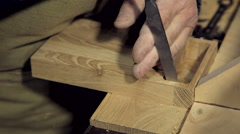 A man works a chisel with a tree - stock footage