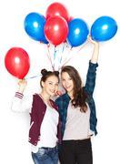 happy teenage girls with helium balloons - stock photo