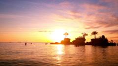 People on vacation, enjoying sunset at tropics. Boracay island. Philippines Stock Footage