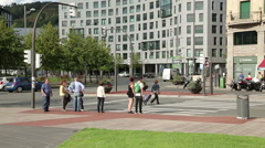 Pedestrians waiting for green traffic light to cross the road in Bilbao, Spain Stock Footage