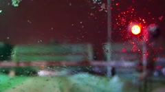 Railroad crossing, train in snowfall, blizzard, non-flying weather, defocus Stock Footage