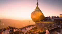 Time lapse of Burmese people praying near Golden Rock at sunset. Myanmar Stock Footage