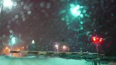 Railroad crossing in snowfall, blizzard, non-flying weather Stock Footage